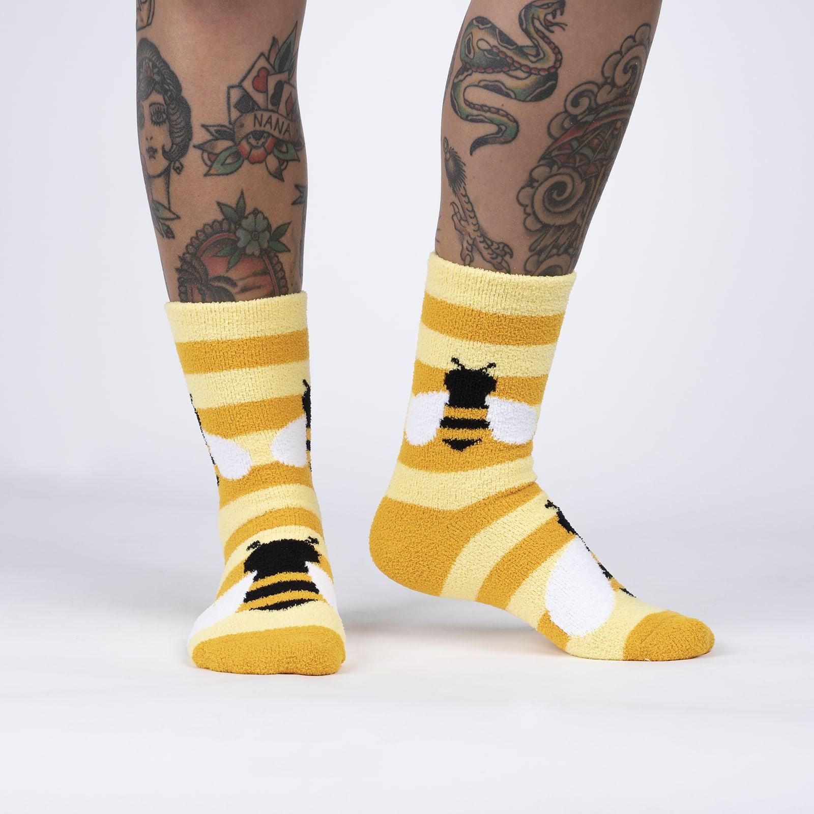 Model wearing Bee Cozy Slipper Socks.